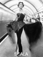 French, John (1907-1966) Model in an Evening Dress in The Underground. London, England, 1960