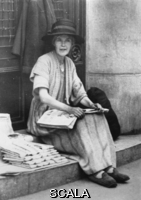 ******** The Russian princess Ikanolowitsch - impoverished by the Revolution - lives from selling newspapers in Paris. About 1930.Photograph