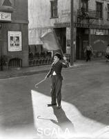 ******** Charlie Chaplin (1889-1977) in a scene from the move 'Modern Times', c. 1935.